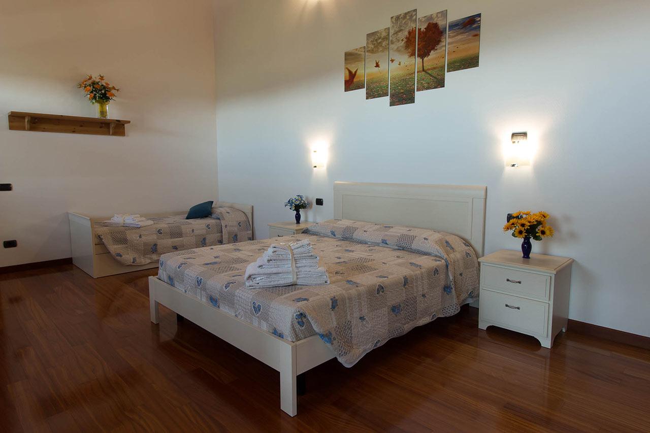 Camera famigliare ad uso tripla